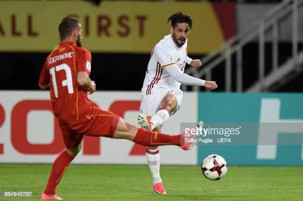 Isco of Spain kicks the ball as Ostoja Stjepanovic od FYR Macedonia tackles during the FIFA 2018 World Cup Qualifier between FYR Macedonia and Spain...