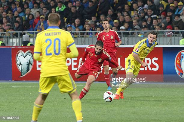 Isco of Spain national team vies with Artem Fedetskyi of Ukraine during the European Qualifiers 2016 match between Ukraine and Spain national teams...