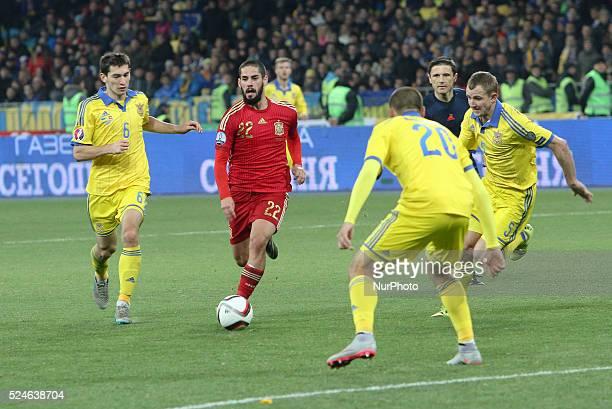 Isco of Spain national team vies with Taras Stepanenko Oleksandr Kucher and Yaroslav Rakytskyi of Ukraine during the European Qualifiers 2016 match...