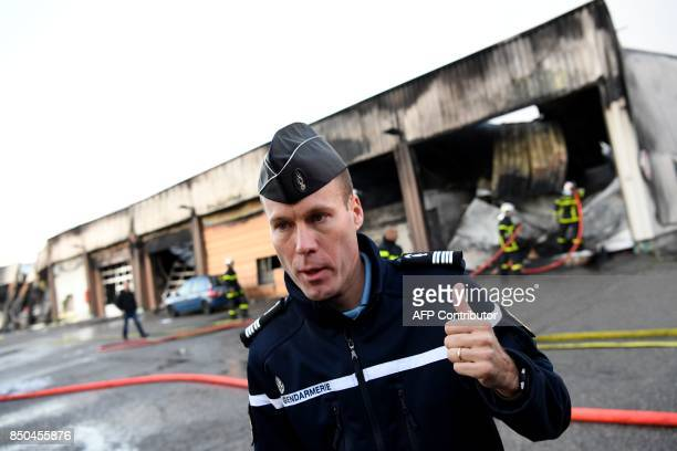 Isere's gendarmerie officer commanding Colonel Yves Marzin speaks to journalists on September 21 2017 in Grenoble eastern France in front of a...