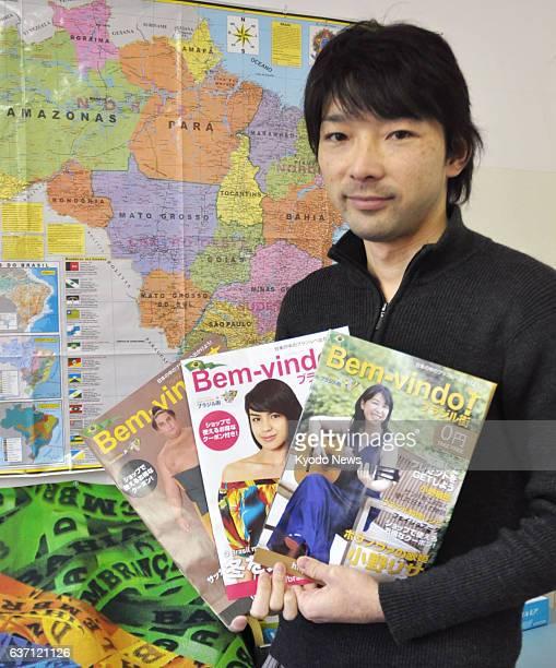 Isesaki Japan Photo taken Jan 24 2014 shows Paulo Issamu Hirano a thirdgeneration Japanese Brazilian who lives in Isesaki Gunma Prefecture holding...