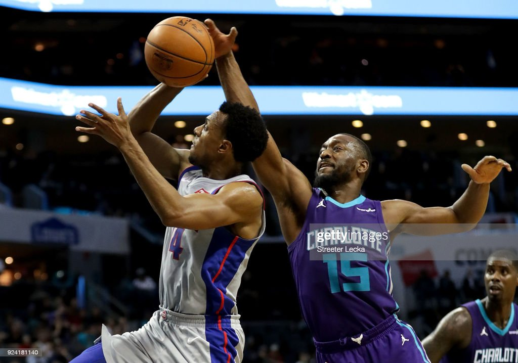 Ish Smith #14 of the Detroit Pistons drives to the basket against Kemba Walker #15 of the Charlotte Hornets during their game at Spectrum Center on February 25, 2018 in Charlotte, North Carolina.