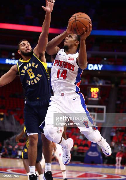 Ish Smith of the Detroit Pistons looks for a open teammate around Cory Joseph of the Indiana Pacers during a pre season game at Little Caesars Arena...