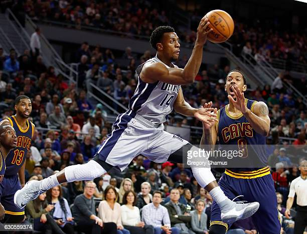 Ish Smith of the Detroit Pistons passes around Channing Frye of the Cleveland Cavaliers but was called for traveling during the first half at the...