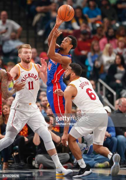 Ish Smith of the Detroit Pistons passes the ball off over Cory Joseph of the Indiana Pacers at Bankers Life Fieldhouse on November 17 2017 in...