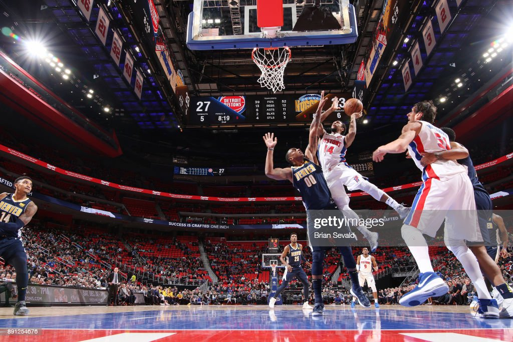 Ish Smith #14 of the Detroit Pistons shoots the ball against the Denver Nuggets on December 12, 2017 at Little Caesars Arena in Detroit, Michigan.