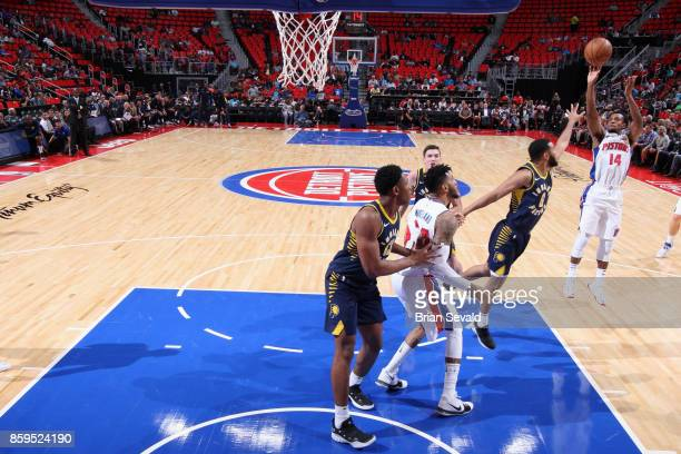 Ish Smith of the Detroit Pistons shoots the ball against the Indiana Pacers on October 9 2017 at Little Caesars Arena in Detroit Michigan NOTE TO...