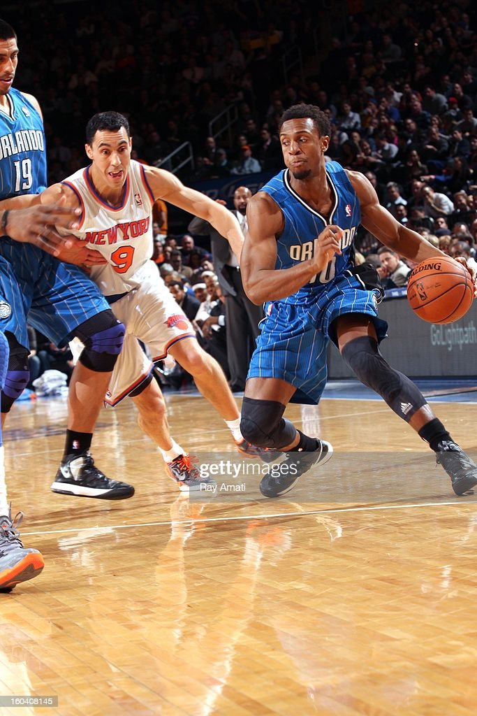 Ish Smith #10 of the Orlando Magic drives against Pablo Prigioni #9 of the New York Knicks during the game between the New York Knicks and the Orlando Magic on January 30, 2013 at Madison Square Garden in New York City .