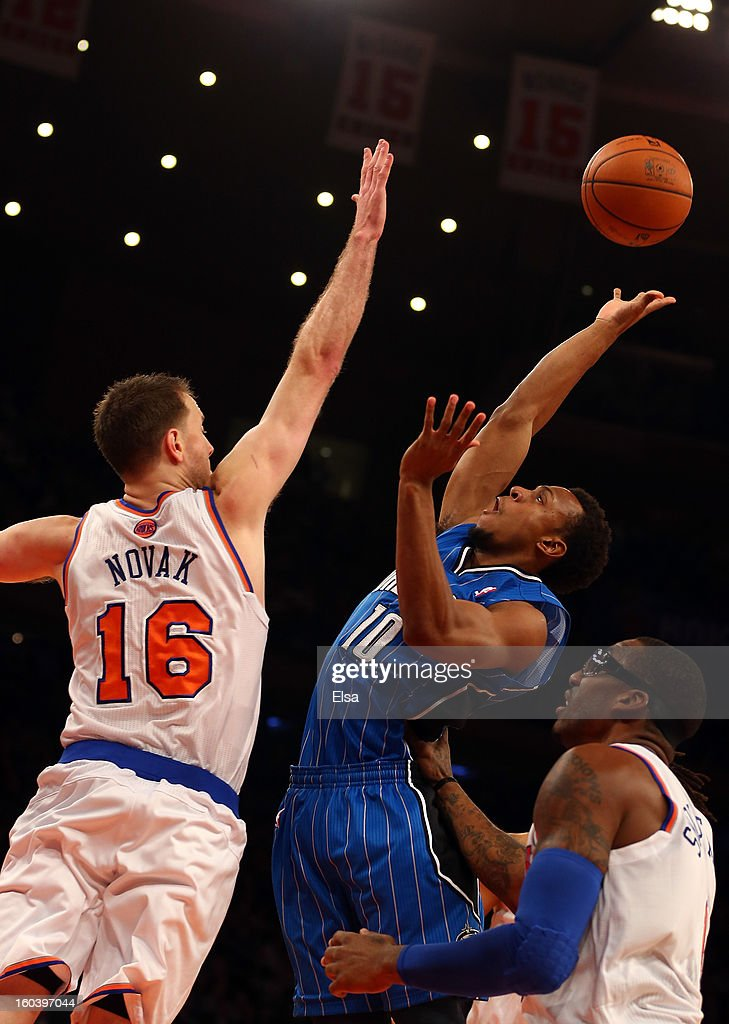 Ish Smith #10 of the Orlando Magic heads for the net as Steve Novak #16 and Amar'e Stoudemire #1 of the New York Knicks defend on January 30, 2013 at Madison Square Garden in New York City.