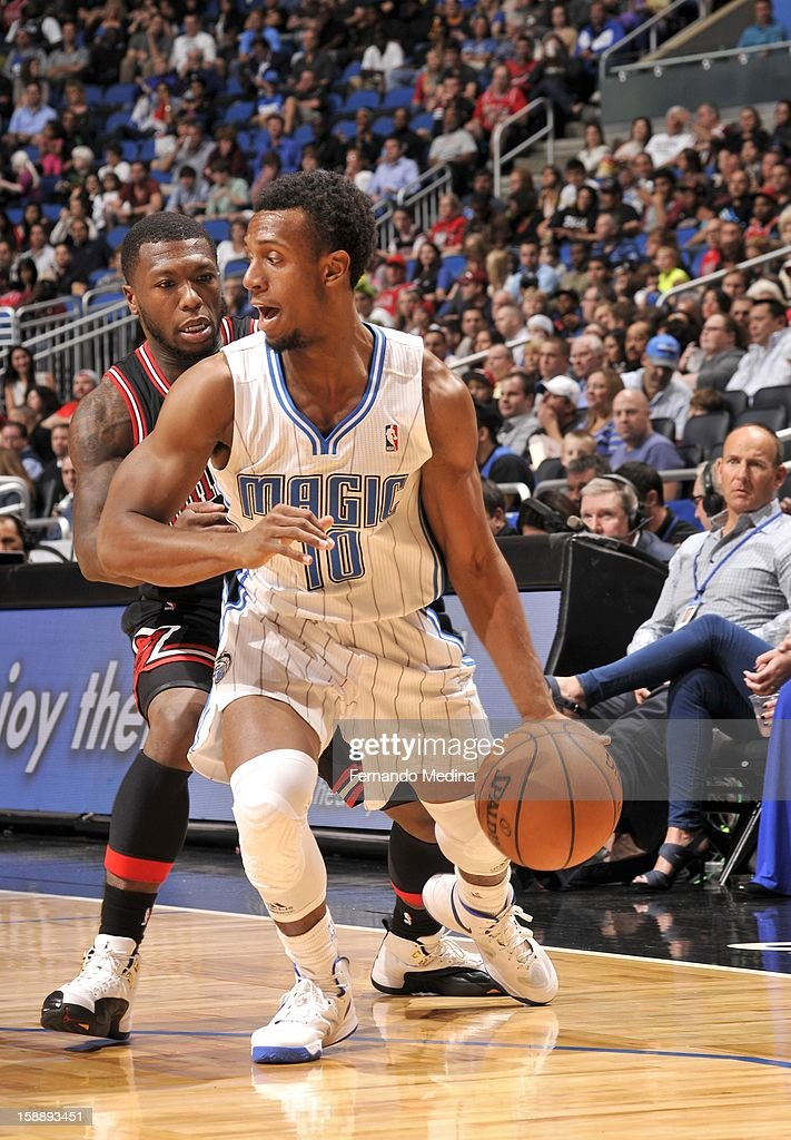 Ish Smith #10 of the Orlando Magic protects the ball from Nate Robinson #2 of the Chicago Bulls during the game between the Chicago Bulls and the Orlando Magic on January 2, 2013 at Amway Center in Orlando, Florida.