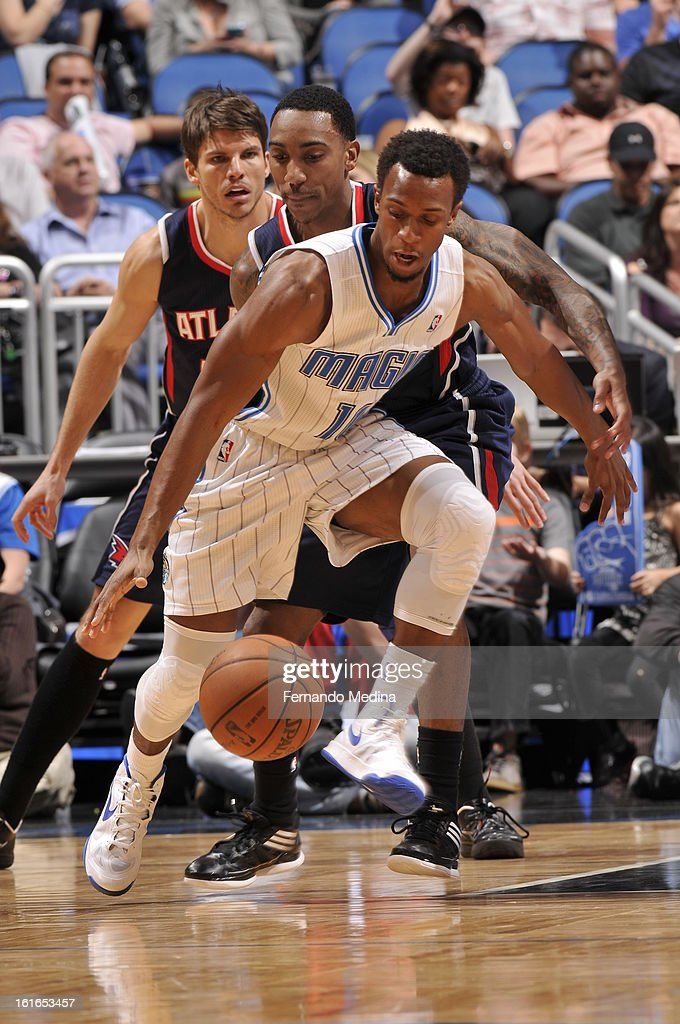 Ish Smith #10 of the Orlando Magic pushes the ball up the court against the Atlanta Hawks during the game on February 13, 2013 at Amway Center in Orlando, Florida.