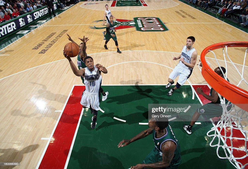 Ish Smith #10 of the Orlando Magic shoots against Brandon Jennings #3 of the Milwaukee Bucks on February 2, 2013 at the BMO Harris Bradley Center in Milwaukee, Wisconsin.