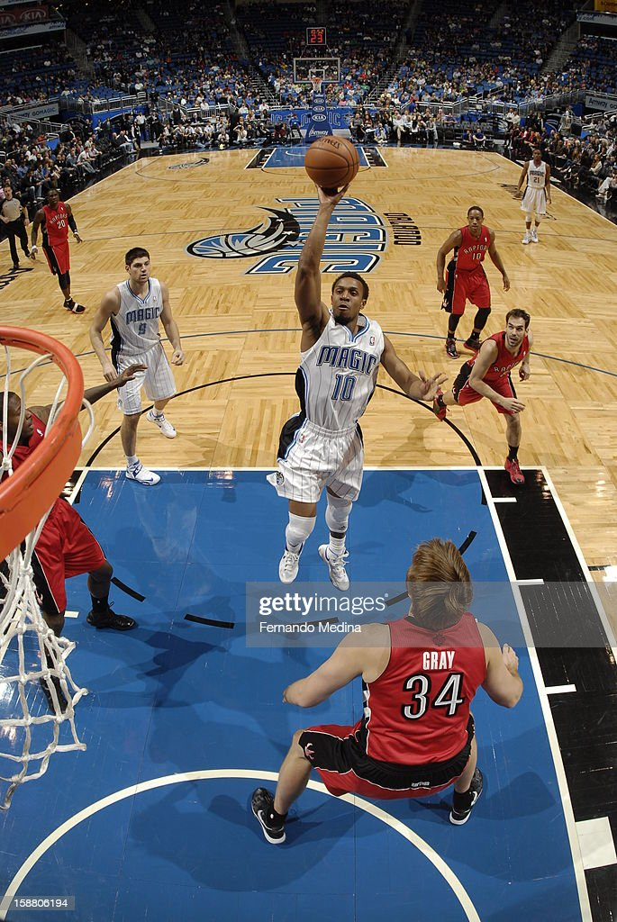 Ish Smith #10 of the Orlando Magic throws up a short shot against the Toronto Raptors during the game on December 29, 2012 at Amway Center in Orlando, Florida.