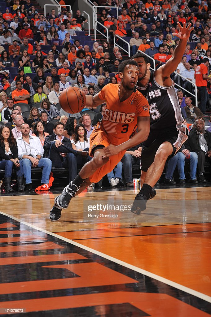 Ish Smith #3 of the Phoenix Suns drives against Cory Joseph #5 of the San Antonio Spurs on February 21, 2014 at U.S. Airways Center in Phoenix, Arizona.