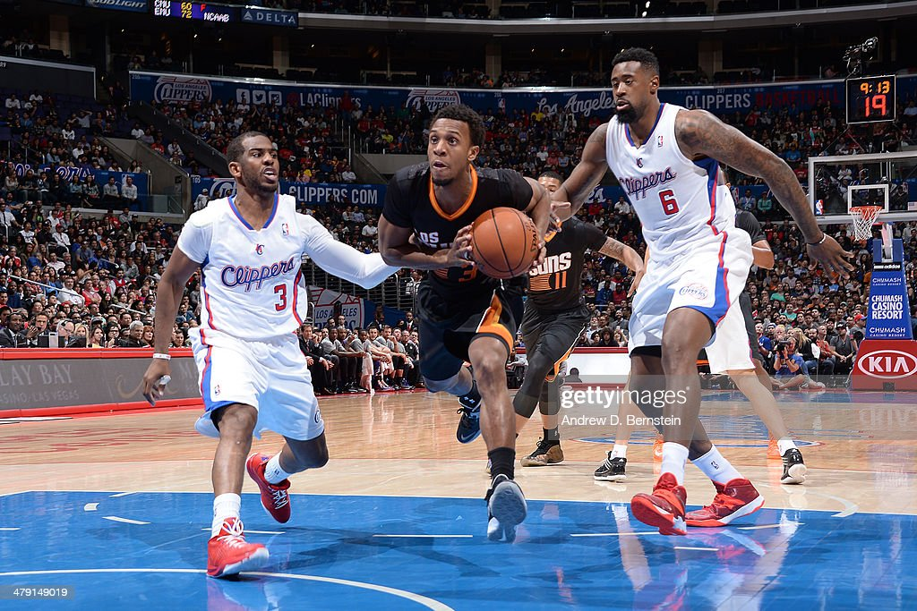 Ish Smith #3 of the Phoenix Suns drives to the basket against the Los Angeles Clippers at Staples Center on March 10, 2014 in Los Angeles, California.
