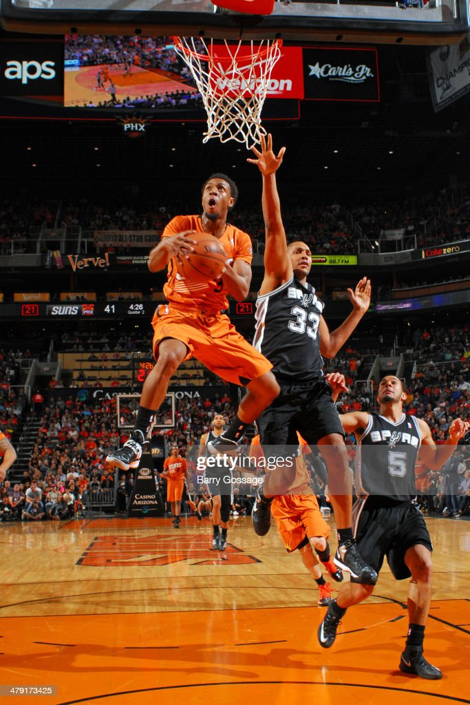Ish Smith #3 of the Phoenix Suns drives to the basket against the San Antonio Spurs on February 21, 2014 at U.S. Airways Center in Phoenix, Arizona.
