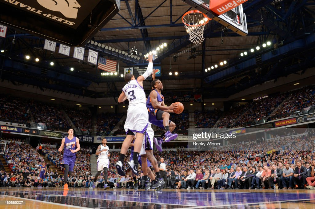Ish Smith #3 of the Phoenix Suns goes up for the shot against Ray McCallum #3 of the Sacramento Kings on April16, 2014 at Sleep Train Arena in Sacramento, California.