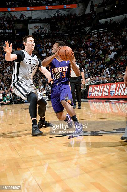 Ish Smith of the Phoenix Suns handles the ball against Aron Baynes of the San Antonio Spurs at the ATT Center on April 11 2014 in San Antonio Texas...
