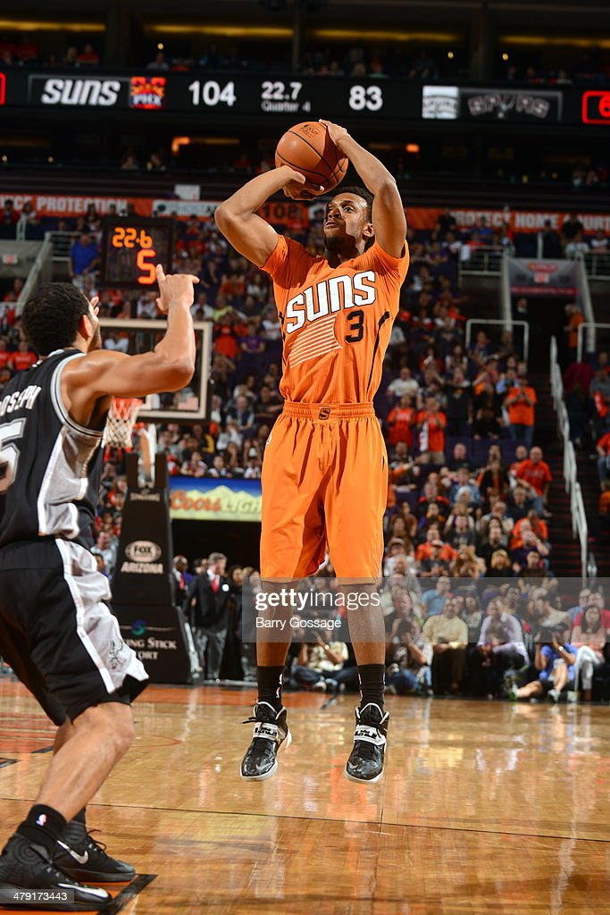 Ish Smith #3 of the Phoenix Suns shoots the ball against the San Antonio Spurs on February 21, 2014 at U.S. Airways Center in Phoenix, Arizona.