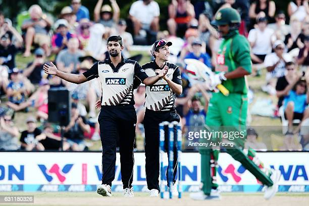 Ish Sodhi celebrates with teammate Trent Boult for his wicket of Soumya Sarkar of Bangladesh during the third Twenty20 International match between...