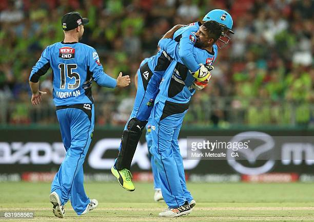 Ish Sodhi of the Strikers celebrates taking the wicket of Arjun Nair of the Thunder during the Big Bash League match between the Sydney Thunder and...