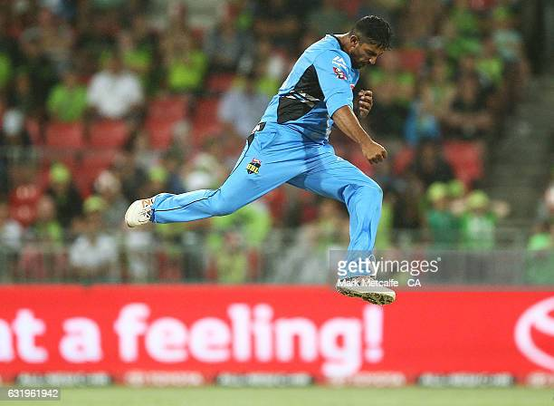Ish Sodhi of the Strikers celebrates taking the wicket of Ben Rohrer of the Thunder during the Big Bash League match between the Sydney Thunder and...