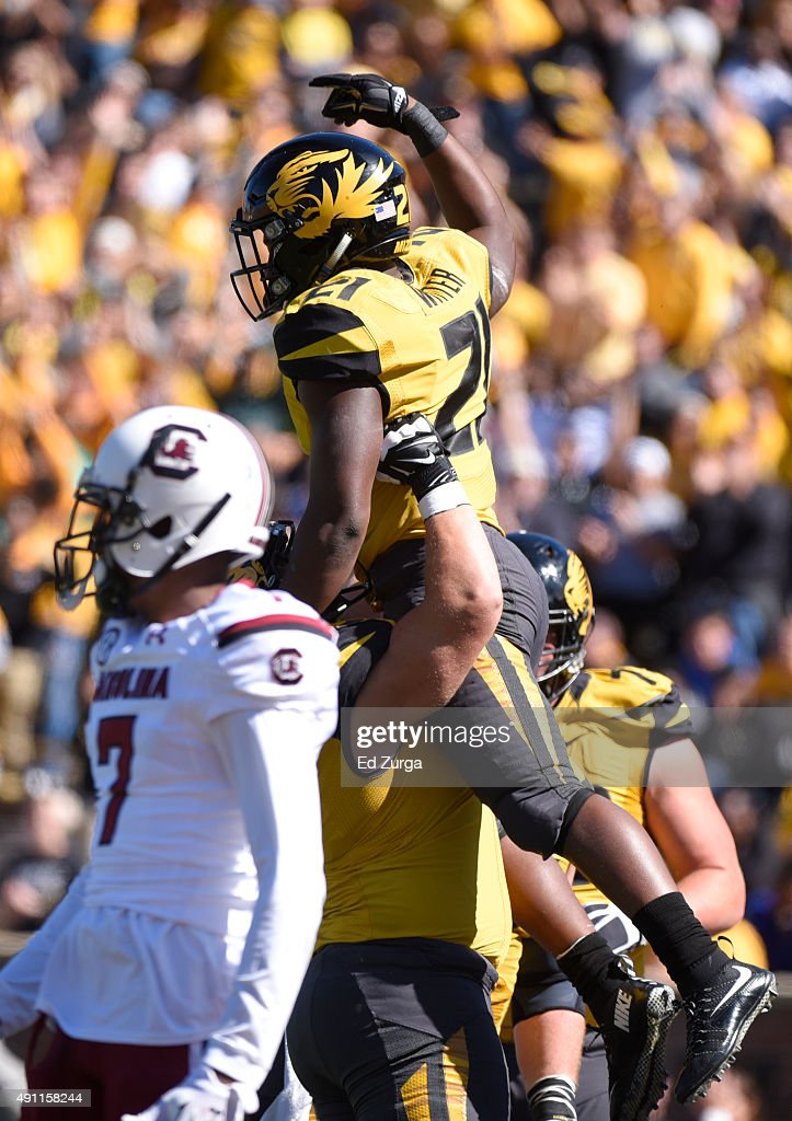 Ish Witter #21 of the Missouri Tigers is hoisted into the air as he celebrates a touchdown in the third quarter South Carolina Gamecocks at Memorial Stadium on October 3, 2015 in Columbia, Missouri.