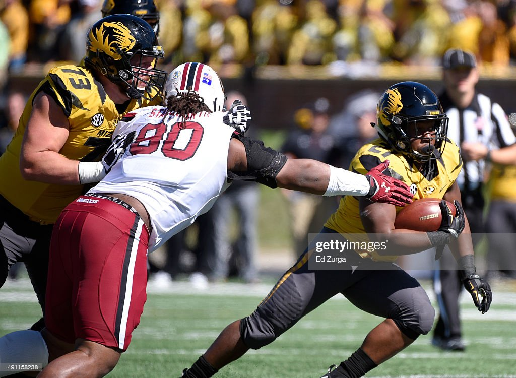 Ish Witter #21 of the Missouri Tigers runs past Taylor Stallworth #90 of the South Carolina Gamecocks in the third quarter at Memorial Stadium on October 3, 2015 in Columbia, Missouri.