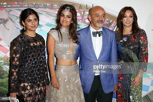 Isha Ambani and Christian Louboutin attend the 'The Art of Giving' Love Ball Naked Heart foundation Photo Call as part of Paris Fashion Week on July...