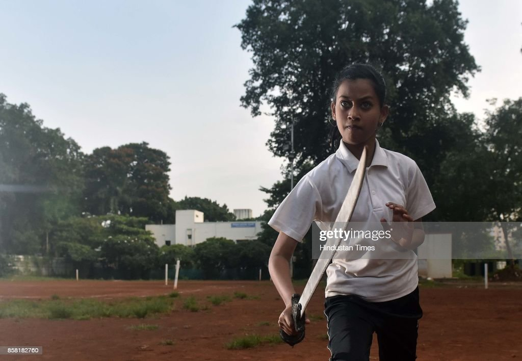 Isha Navgire displays Sword Swing, a type of Silambam, a weapon based Indian Martial arts, on October 4, 2017 in Pune, India. The word Silambam means either a mountain or merely to sound (as verb). While the Silambam fencers are fighting, the weapon makes sound. This might have been the cause for its being named as Silambam.