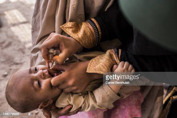 Ishak 3 months is held by his mother displaced from her home due to the Pakistan Army's latest Military offensive in the Bara area of Khyber Tribal...