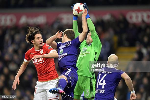 Ishak Belfodil forward of Standard Liege battles for the ball with Frank Boeckx goalkeeper of RSC Anderlecht and Uros Spajic defender of RSC...
