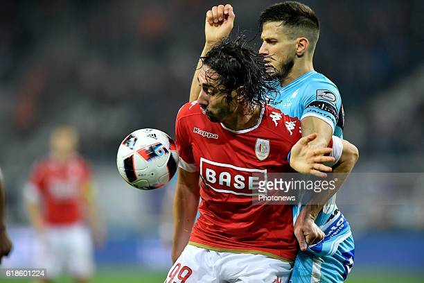 Ishak Belfodil forward of Standard Liege is fighting for the ball with Rami Gershon defender of KAA Gent during the Jupiler Pro League match between...