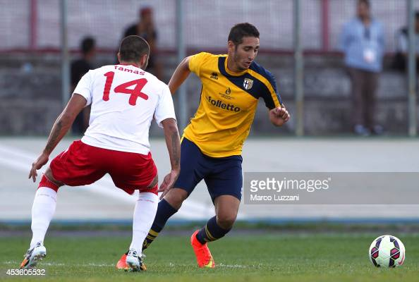 Ishak Belfodil of FC Parma is challenged by Krisztian Tamas of AS Varese during the preseason friendly match between AS Varese and FC Parma at Stadio...