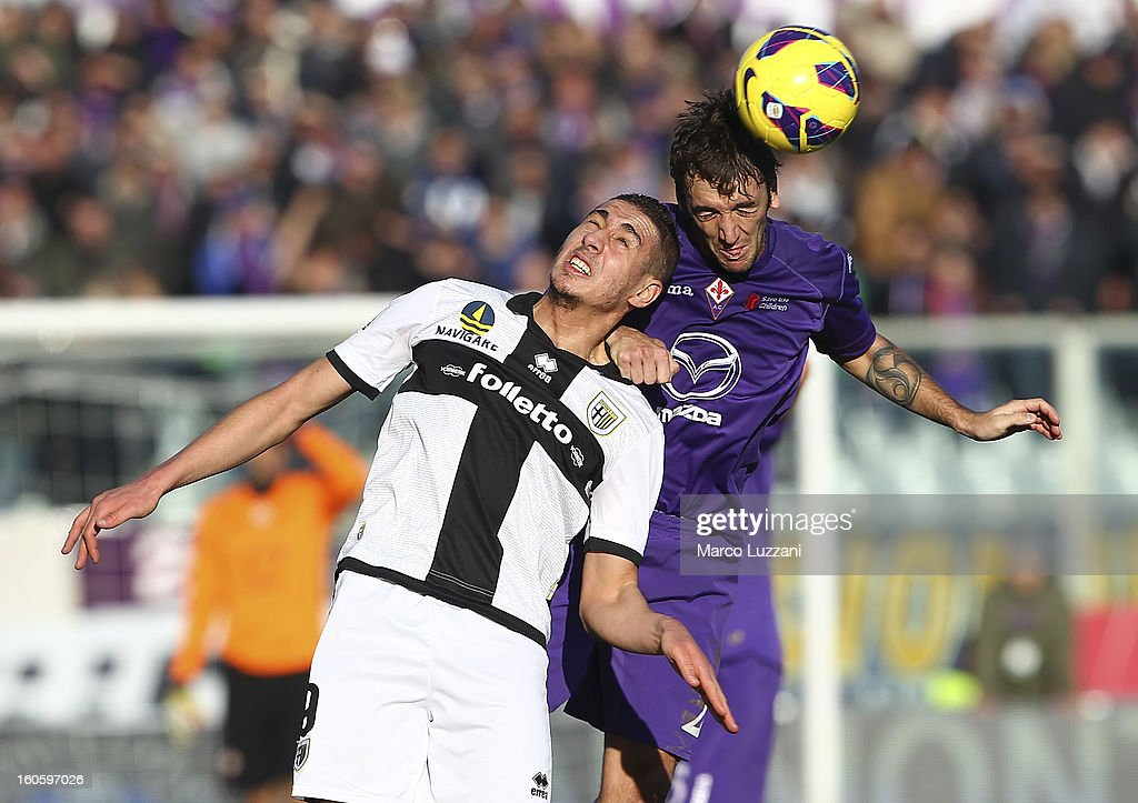 <a gi-track='captionPersonalityLinkClicked' href=/galleries/search?phrase=Ishak+Belfodil&family=editorial&specificpeople=6175690 ng-click='$event.stopPropagation()'>Ishak Belfodil</a> of Parma FC competes for the ball with Gonzalo Rodriguez of ACF Fiorentina during the Serie A match between ACF Fiorentina and Parma FC at Stadio Artemio Franchi on February 3, 2013 in Florence, Italy.