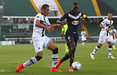 Ishak Belfodil of Parma FC competes for the ball with Lamine Sane of FC Girondins de Bordeaux during a preseason tournament match between Parma FC US...