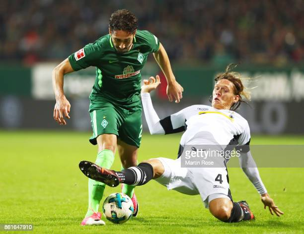 Ishak Belfodil of Werder Bremen is challenged by Jannik Vestergaard of Borussia Moenchengladbach during the Bundesliga match between SV Werder Bremen...