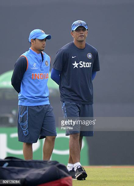 Ishan Kishan of India walks with coach Rahul Dravid of India after having a closer look at the pitch before the ICC U19 World Cup SemiFinal match...