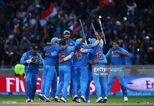 Ishant Sharma jumps onto his teammates as the India team celebrate winning the ICC Champions Trophy Final match between England and India at...