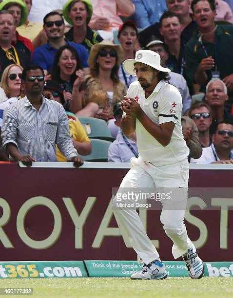 Ishant Sharma of India catches out David Warner of Australia off the bowling of Karn Sharma during day one of the First Test match between Australia...