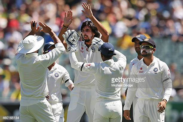 Ishant Sharma of India celebrates his dismissal of Chris Rogers of Australia with teamates during day one of the First Test match between Australia...