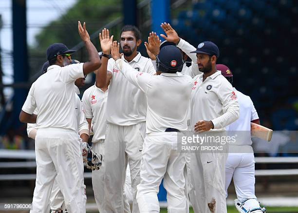 Ishant Sharma of India celebrates the dismissal of Leon Johnson of West Indies during day 1 of the 4th and final Test between West Indies and India...