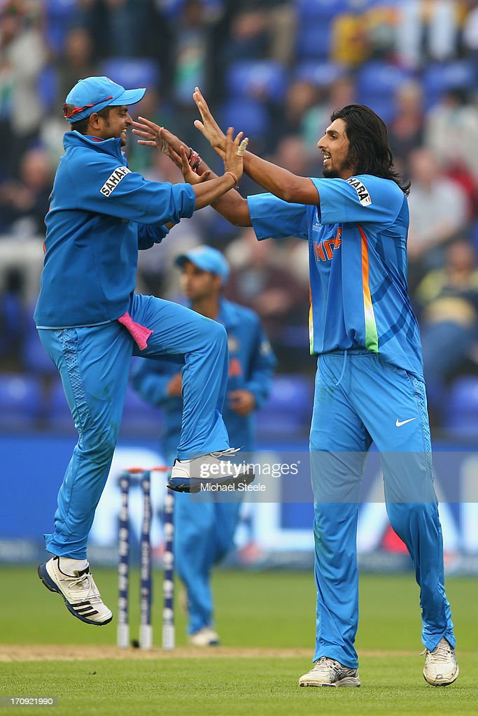<a gi-track='captionPersonalityLinkClicked' href=/galleries/search?phrase=Ishant+Sharma&family=editorial&specificpeople=4305535 ng-click='$event.stopPropagation()'>Ishant Sharma</a> (R) of India celebrates with <a gi-track='captionPersonalityLinkClicked' href=/galleries/search?phrase=Suresh+Raina&family=editorial&specificpeople=542210 ng-click='$event.stopPropagation()'>Suresh Raina</a> (L) after taking the wicket of Thisara Perera of Sri Lanka during the ICC Champions Trophy Semi-Final match between India and Sri Lanka at the SWALEC Stadium on June 20, 2013 in Cardiff, Wales.