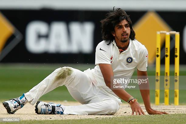 Ishant Sharma of India falls over in his follow through during day four of the Third Test match between Australia and India at Melbourne Cricket...