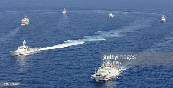 Ishigaki Japan Photo from a Kyodo News airplane shows vessels from the China Maritime Surveillance and the Japan Coast Guard in Japan's territorial...