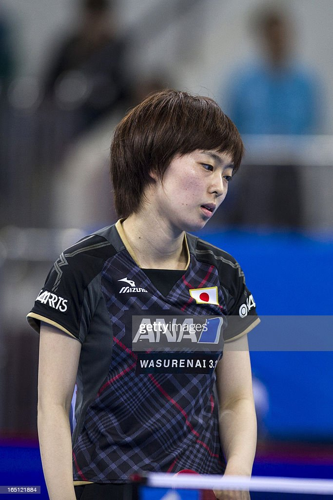 Ishikawa Kasumi of Japan reacts after losing her final match against Wu Yang of China at the World Team Classic Table Tennis match in Guangzhou, east China's Guangdong province on March 31, 2013.
