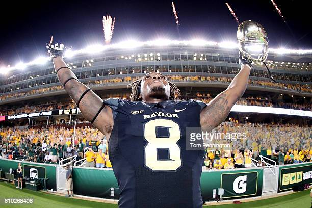 Ishmael Zamora of the Baylor Bears celebrates after the Baylor Bears beat the Oklahoma State Cowboys 3524 at McLane Stadium on September 24 2016 in...