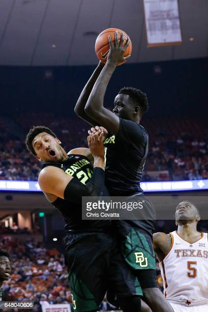 Ishmail Wainright and Nuni Omot of the Baylor Bears collide as they go for a rebound against the Texas Longhorns at the Frank Erwin Center on March 4...