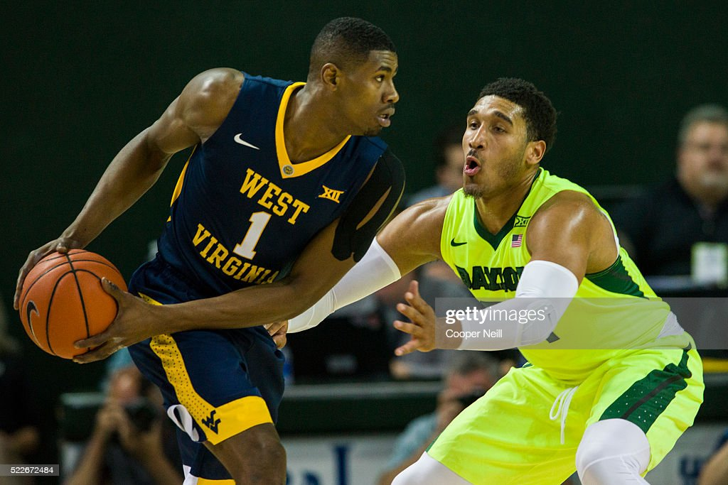 Ishmail Wainright of the Baylor Bears defends against Jonathan Holton the West Virginia Mountaineers on March 5 2016 at the Ferrell Center in Waco...
