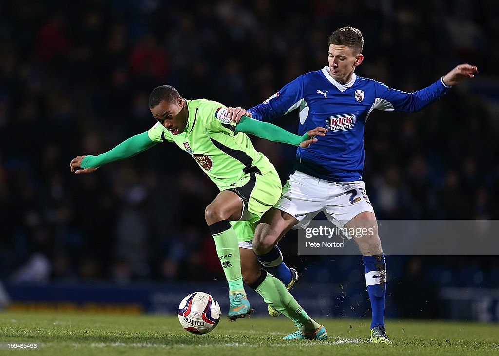 Ishmel Demontagnac of Northampton Town attempts to control the ball under pressure from Mark Randall of Chesterfield during the npower League Two match between Chesterfield and Northampton Town at the Proact Srtadium on January 12, 2013 in Chesterfield, England.